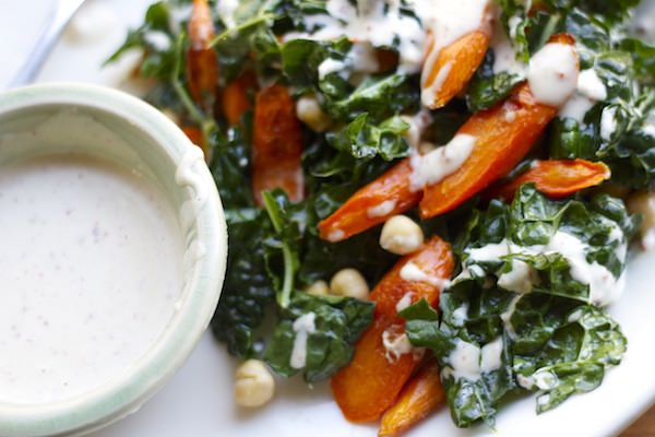 kale salad with roasted carrots, chickpeas + spiced tahini dressing